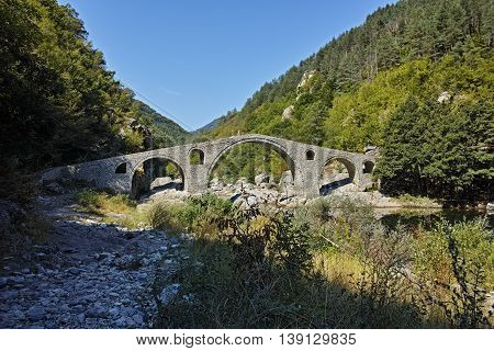 Reflection of The Devil's Bridge in Arda river and Rhodopes mountain, Kardzhali Region, Bulgaria