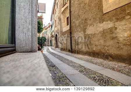 View of ancient street of Como Italy