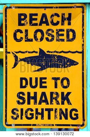 MYRTLE BEACH SOUTH CAROLINA JUNE 29 2016 Sign warns against the possible danger of sharks at a beach.