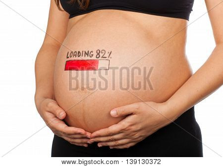 Pregnant Woman With Loading Concept Painted On Her Belly.