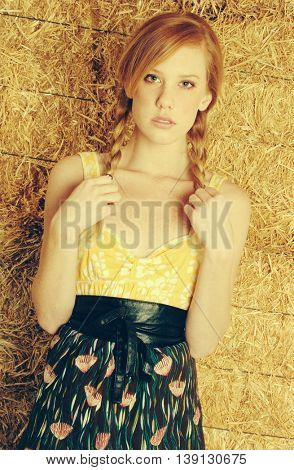 Pretty redhead country girl in hay