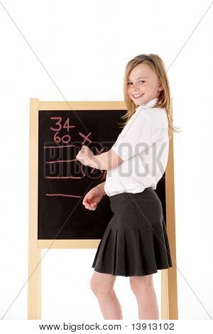 Thoughtful Female Student Wearing Uniform Next To Blackboard