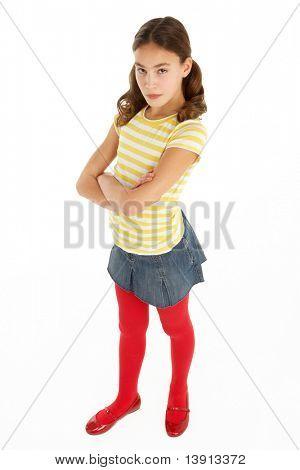 Studio Portrait Of Defiant Young Girl