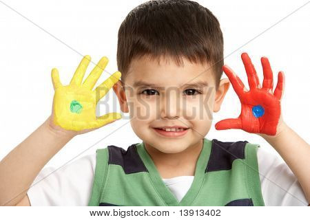Studio Portrait Of Young Boy With Painted Hands