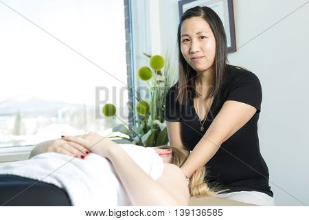 A Beautiful woman receiving massage from physical therapist