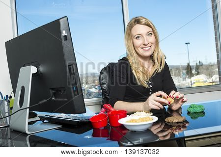 A Cute young nutritionist in a office