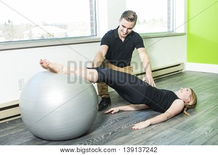 A woman doing exercise with large ball