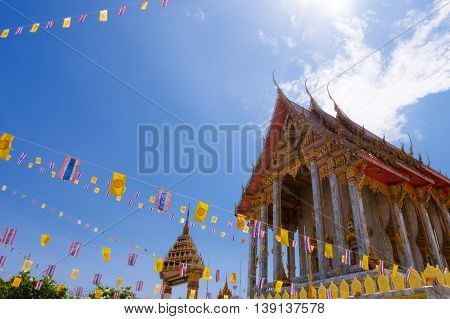 temple decorate with Thailand flag and yellow Buddhism symbol flag to celebrating big Buddhism day.