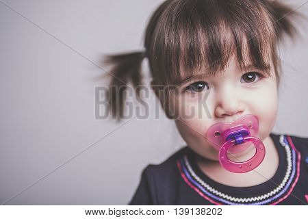 A Portrait of a 2 year old girl on studio suck