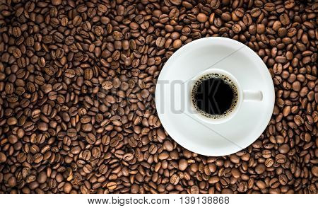 Coffee Cup With Roasted Beans Background
