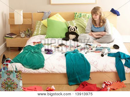 Teenage Girl In Untidy Bedroom