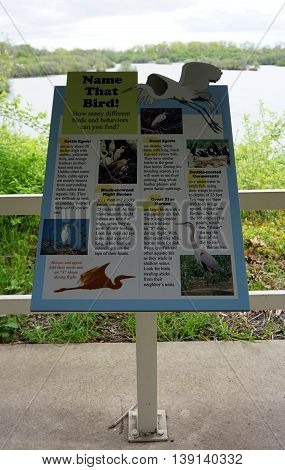 PLAINFIELD, ILLINOIS / UNITED STATES - MAY 4, 2015: An educational sign describes the major birds that may be seen by visitors to the Lake Renwick Heron Rookery Nature Preserve in Plainfield.