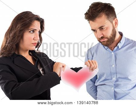 Angry woman tearing a red paper heart
