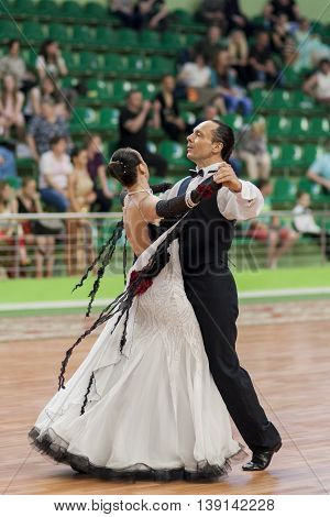 Minsk Belarus -May 29 2016: Senior Dance couple of Zadruckiy Sergey and Zadruckaya Tatiana performs Adult European Standard Program on National Championship of the Republic of Belarus in May 29 2016 in Minsk Belarus