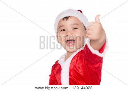 Young boy as Santa Claus showing OK sign isolated on white background. Boy as Santa Claus