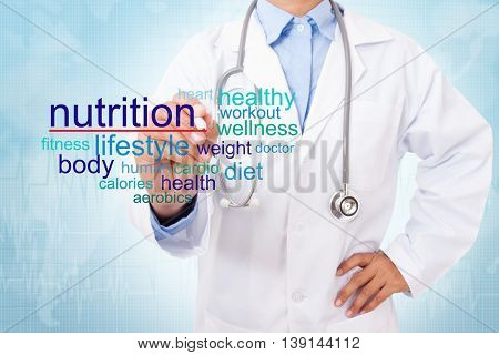 Doctor writing nutrition word on medical background