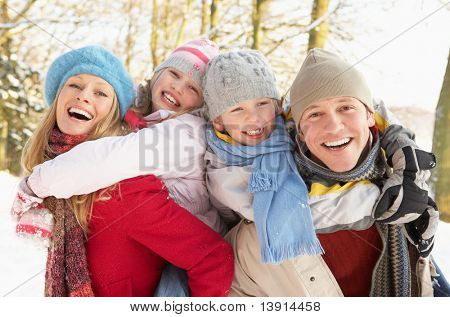 Family Having Fun Snowy Woodland