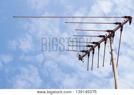 outdoor antenna on house roof with the blue sky