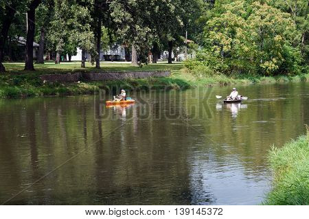 SHOREWOOD, ILLINOIS / UNITED STATES - AUGUST 30, 2015: People ride kayaks down the Du Page River in Shorewood.