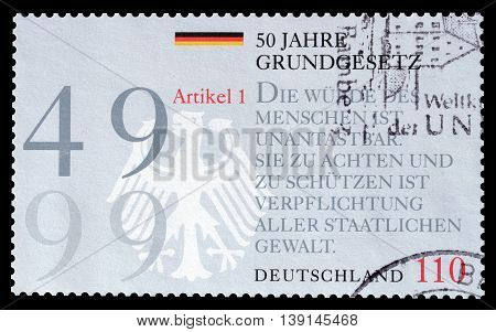 GERMANY - CIRCA 1999 : Cancelled postage stamp printed by Germany, that promotes 50th anniversary of constitution clown drawing.