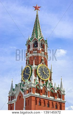 Moscow Kremlin Red Square. Spasskaya (Savior's) clock tower decorated by the red ruby star on the top of it. Blue sky background. UNESCO World Heritage Site.