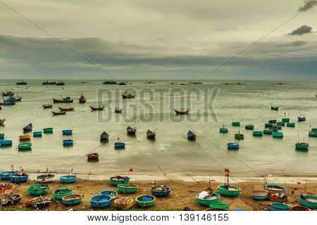 The fishing fleet assembled on and off the beach in Vietnam