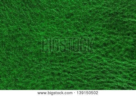 Green decorative leather texture background, close up
