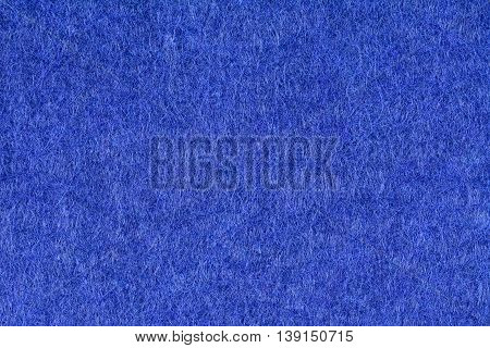 Blue woolen fabric texture background, close up