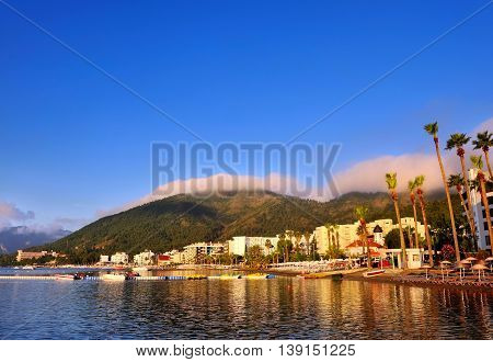 Beautiful morning seascape with boats and mountains in the background. Marmaris. Turkey