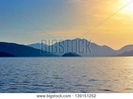 Beautiful Morning Seascape With Mountains In The Background