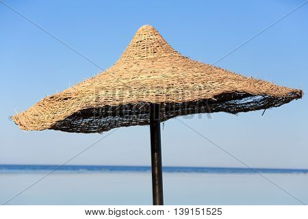 Beach Umbrella And Blue Sky Background