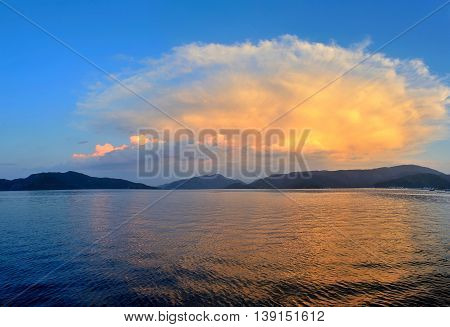 Beautiful Seascape With Mountains In The Background. Sunset
