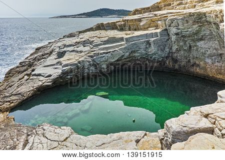 Green waters of Giola Natural Pool in Thassos island, East Macedonia and Thrace, Greece