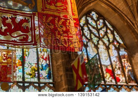 Flags And Stained Glass Windows Inside St Giles Cathedral