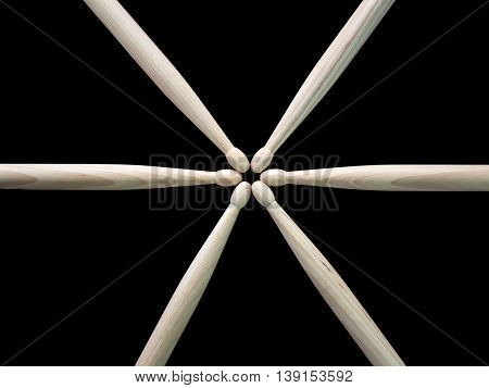 Many drumsticks in black background, close up shot