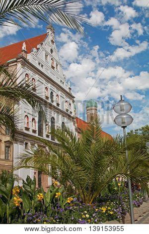 Pedestrian Area Munich With Beautiful Flowerpots And Saint Michael Church