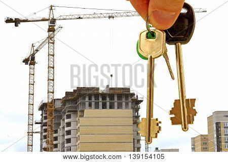 House keys on a background of construction  .