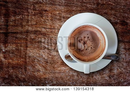 Empty hot coffee cup after drink on wood table.