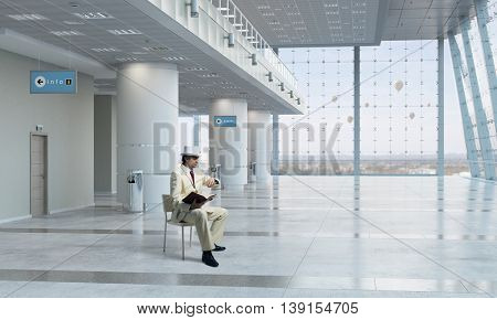 Businessman reading book . Mixed media