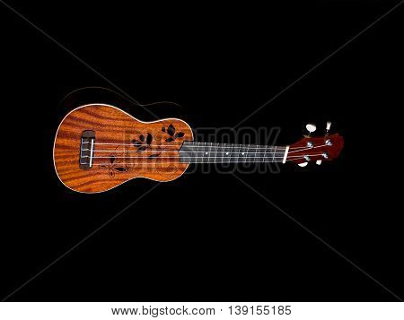 hawaii ukulele guitar isolated against black background
