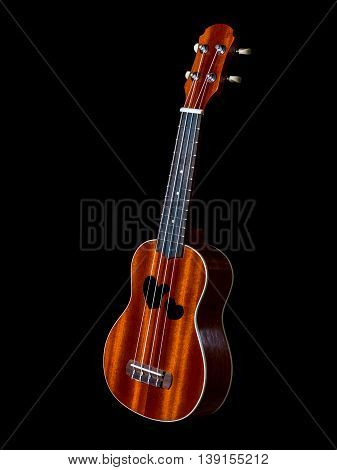 hawaii ukulele guitar isolated against black background heart sound hole