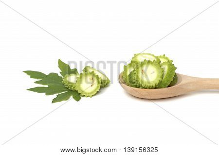Slices of bitter gourd on white background