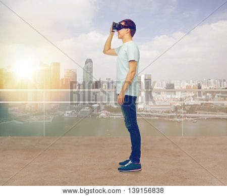 3d technology, virtual reality, entertainment, cyberspace and people concept - happy man with virtual reality headset or 3d glasses looking at something over singapore city skyscrapers background