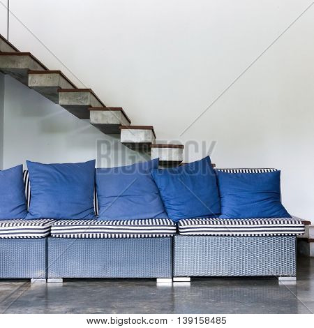 Interior Living Room Modern Style With Blue Sofa Furniture And Staircase In White Room