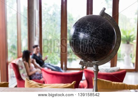 Model Of Black World Decorated In Living Room With Furniture Background