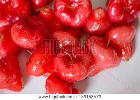 Mini rose apples on white table stock photo
