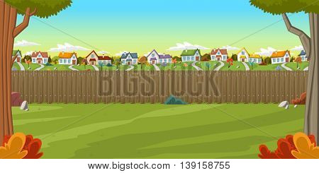 Wood fence on the backyard of a colorful house in suburb neighborhood. Green garden with grass, trees, flowers and clouds.