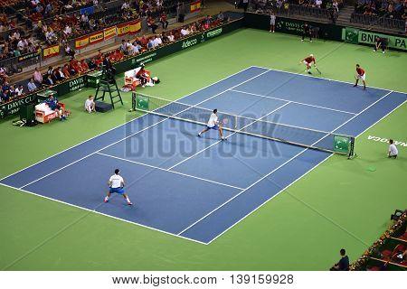 Men Doubles Tennis Match