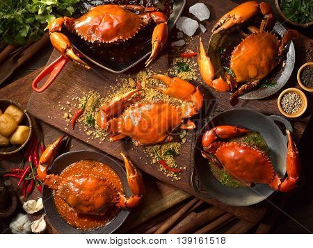 Fried Crab in Singapore style on wooden cutting board in asia