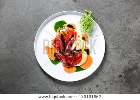 Sustainable dish beef on white plate with sauces and herbs